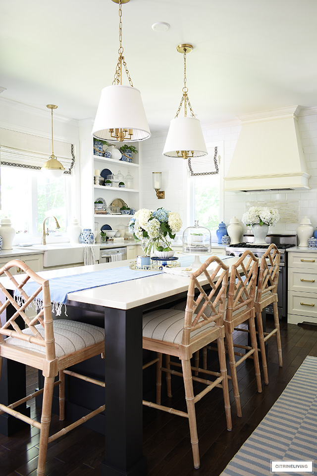 Kitchen decorating with summer touches - blue and white, striped rugs and hydrangeas.