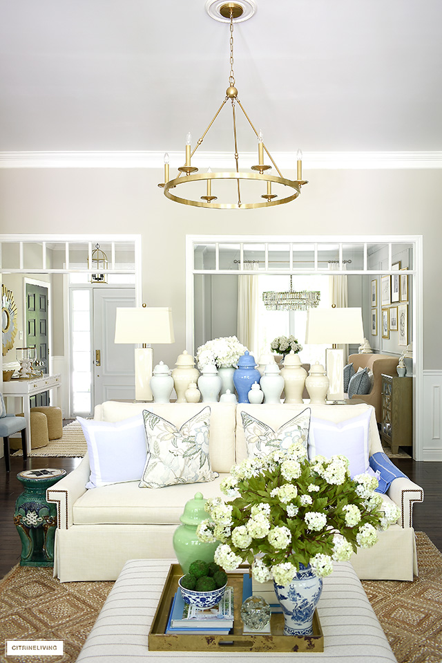 Gorgeous summer living room decorated with a fresh blue, green and natural palette is light and airy for the warm months!