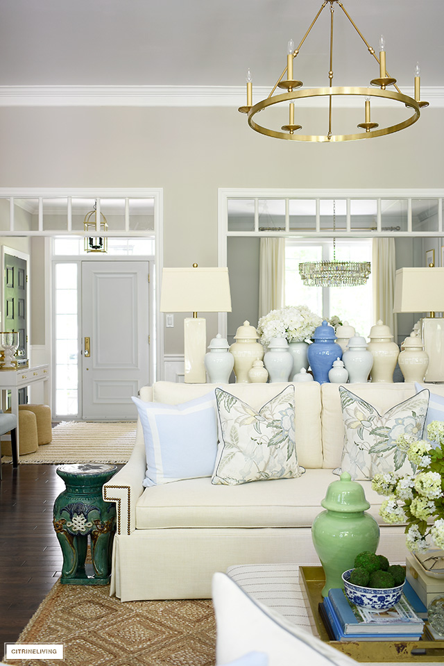 Living room decorated for summer with a beautiful blue, green and natural palette.