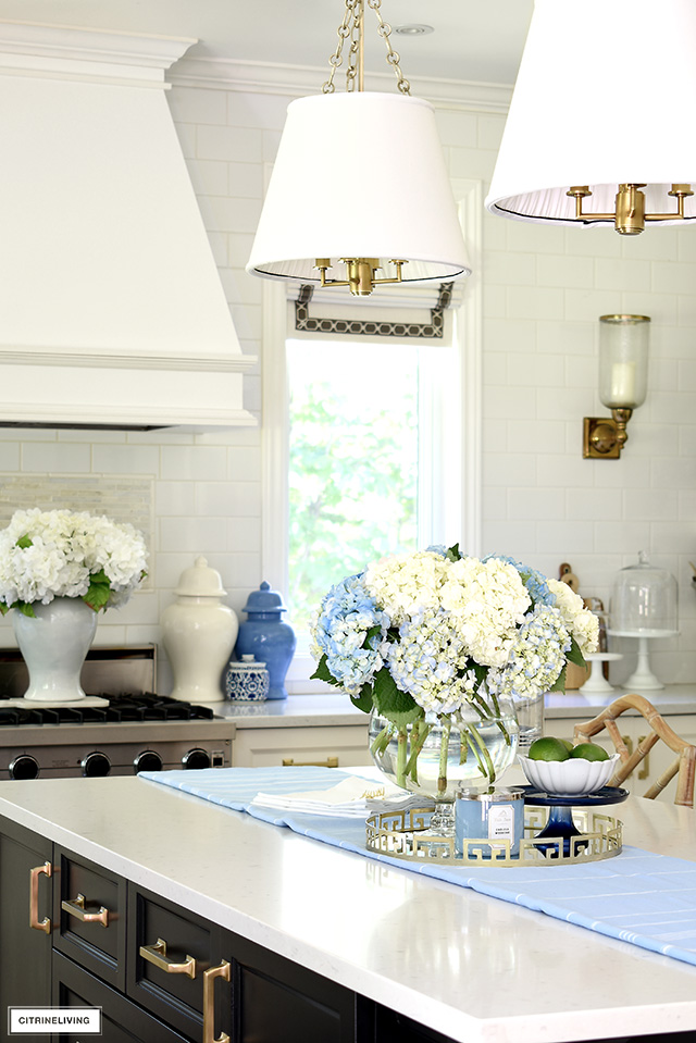 Kitchen island styled with beautiful blue and white hydrangeas.