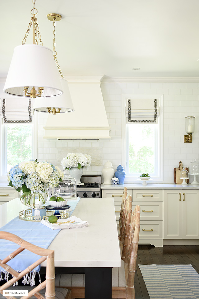 Fresh summer kitchen decor - blue and white, hydrangeas, ginger jars and striped rugs.