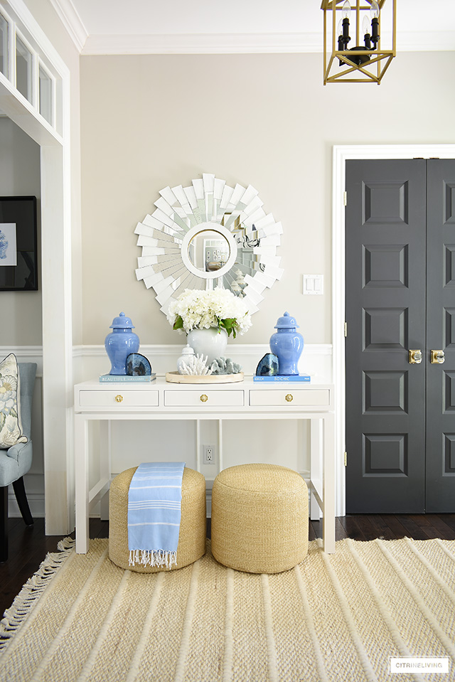 Gorgeous summer entryway decor with white blue and natural decor.