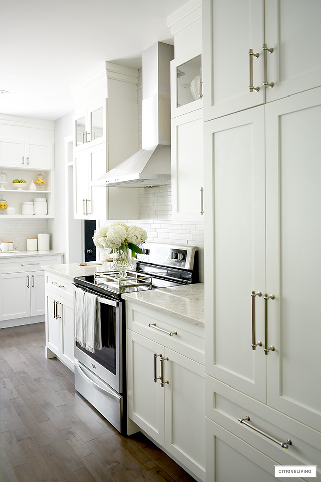 Gorgeous white kitchen featuring shaker style cabinets with brushed silver pulls.