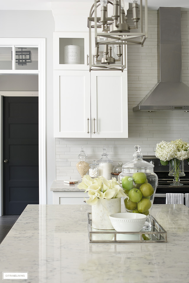 Beautiful classic-meets-modern kitchen with white cabinetry and satin nickel hardware.