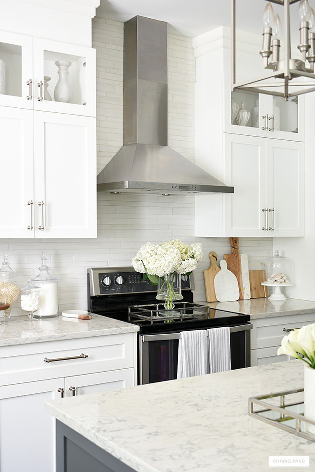 White cabinets featuring Satin Nickel handles gives a beautiful upscale look.