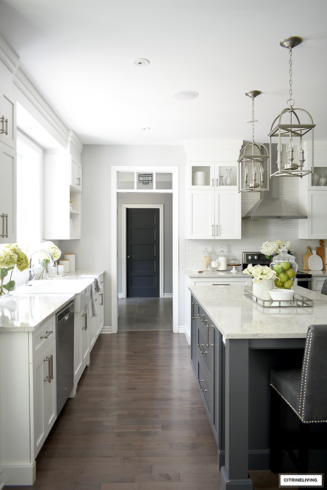 Gorgeous white and grey kitchen with brushed silver accents and hardware.