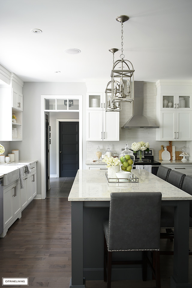 Gorgeous white kitchen with brushed silver hardware and accents throughout.