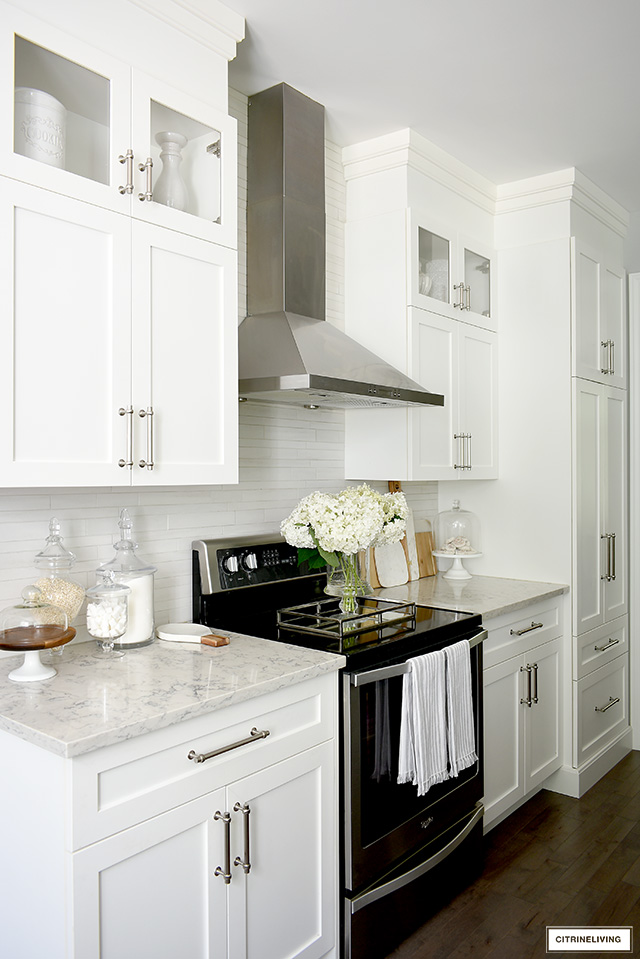 Classic white shaker cabinets with brushed silver hardware.