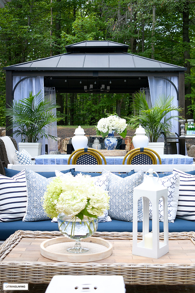 Outdoor lounge area with gazebo, dining space and living room.