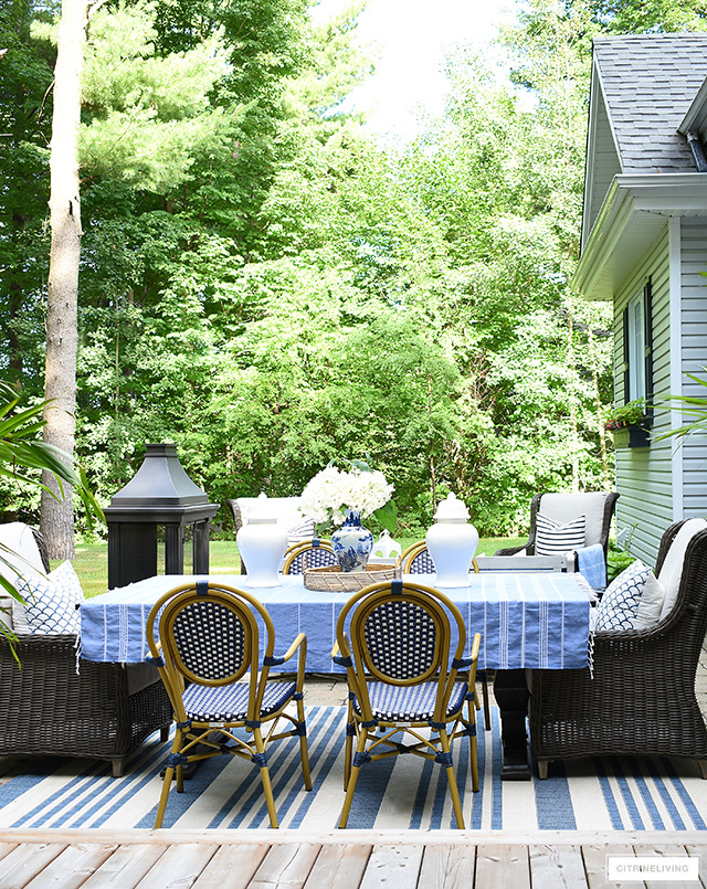 Backyard dining table with wingback chairs and bistro chairs.
