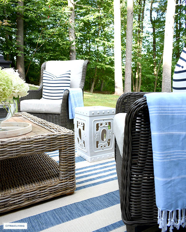 Outdoor white ceramic garden stool.