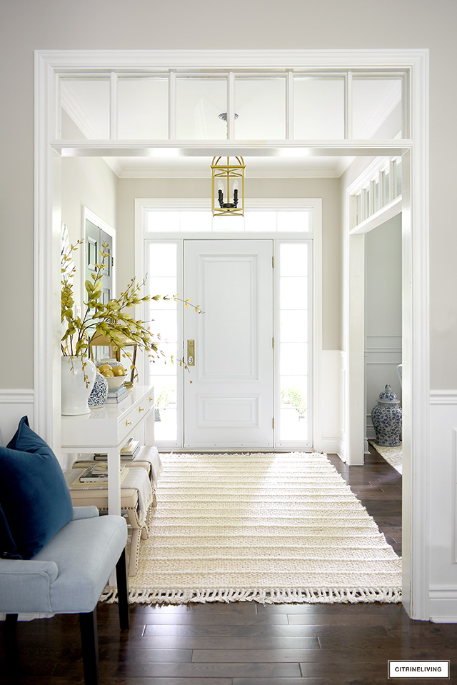Bright and airy foyer decorated for fall with soft colors, textures and layers.