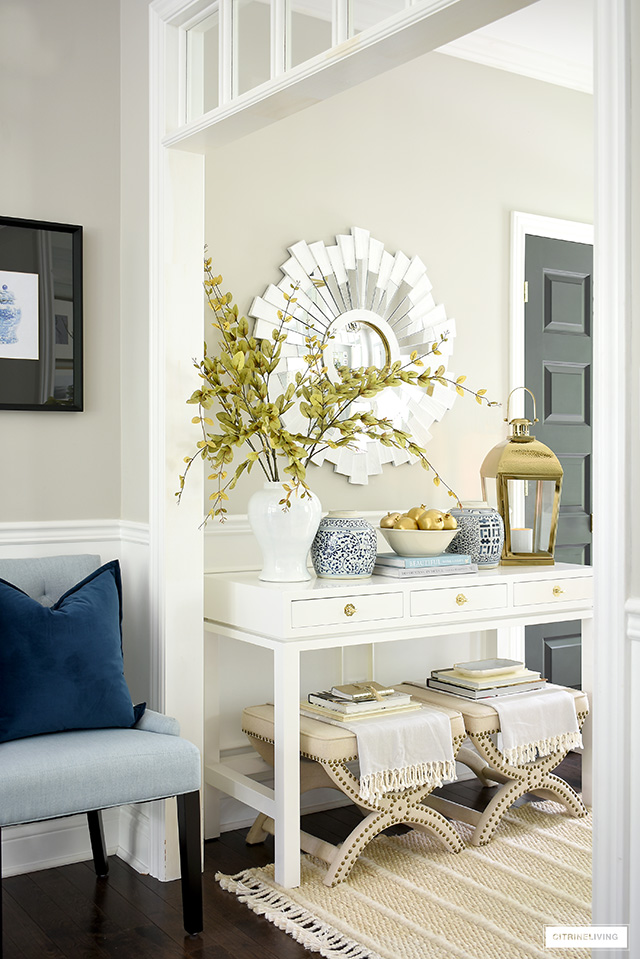 Entryway decorating with blue and white ginger jars, gold accents and soft neutral layers for fall.