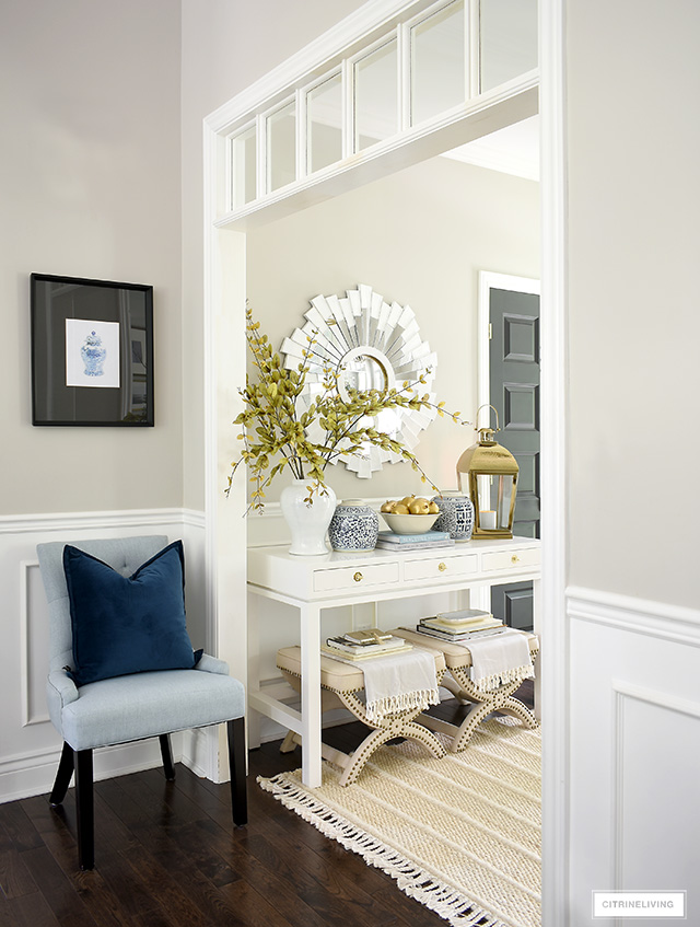Beautiful and elegant entryway decorating for fall with blue and white, gold and soft textures and layers.