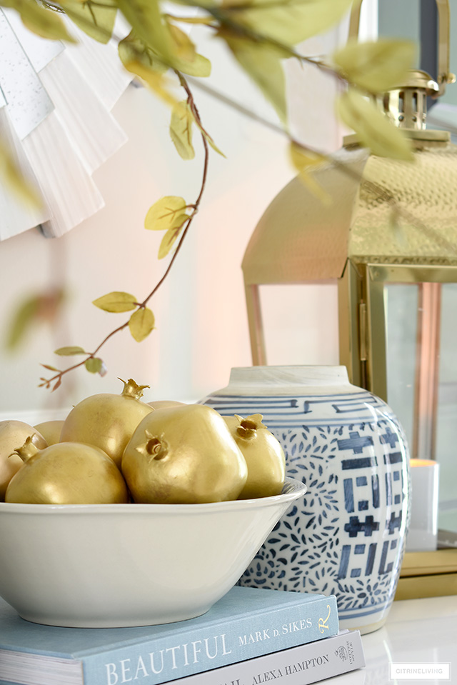 Gorgeous gold painted faux pomegranates are perfect for fall and holiday decor!
