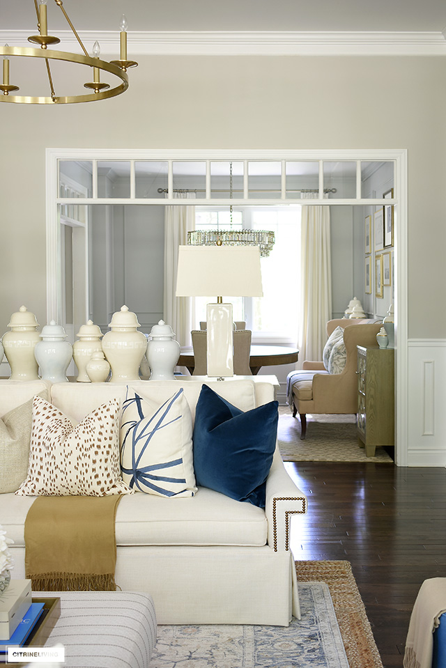 Fall living room decorating with a peek into a chic dining room.