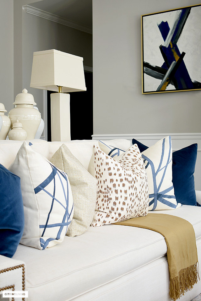 A beautiful mix of chic and elegant throw pillows - navy velvet, Kelly Wearstler channels in navy and Les Touches in Tan.