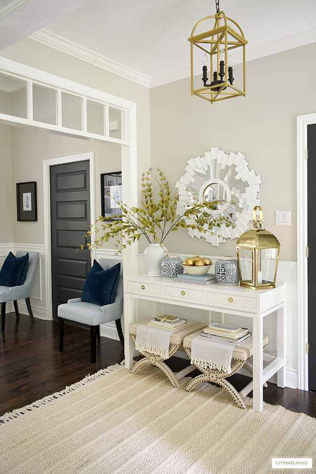 Entryway decorated for fall with soft collars and textures - bring in an elegant touch with gold, blue and white!
