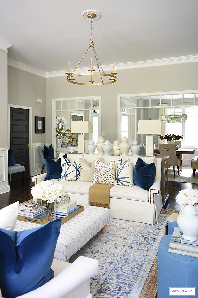 Living room fall decor with navy blue accents, brown, gold and cream.