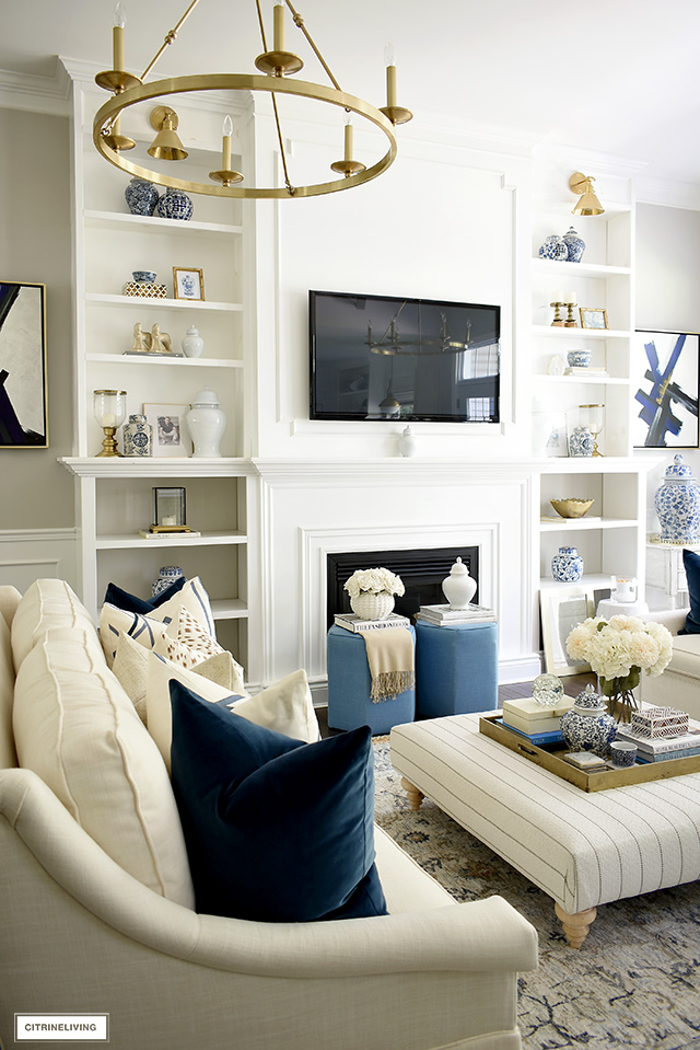 Living room decorated for fall with blue, gold, brown, and cream accents.