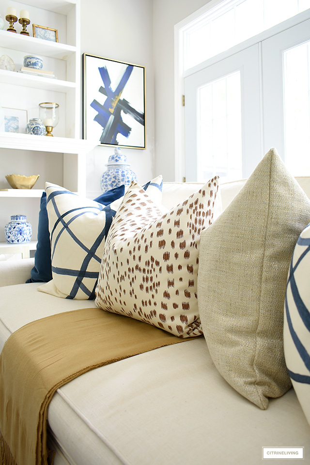 Tan and cream Les Touches throw pillow and camel throw for fall.
