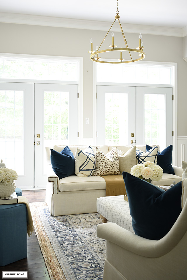 French doors, with transoms let in beautiful natural light in this chic and elegant living room! Fall decorating in navy, brown, cream and gold is a sophisticated color palette.