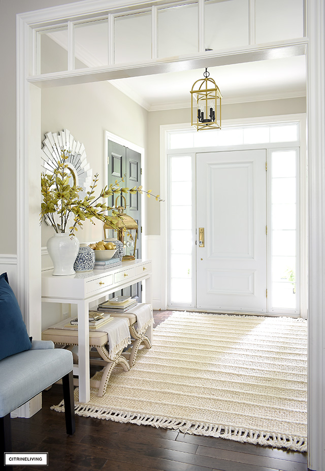 Elegant fall entryway decor with soft tones, textures and layers.