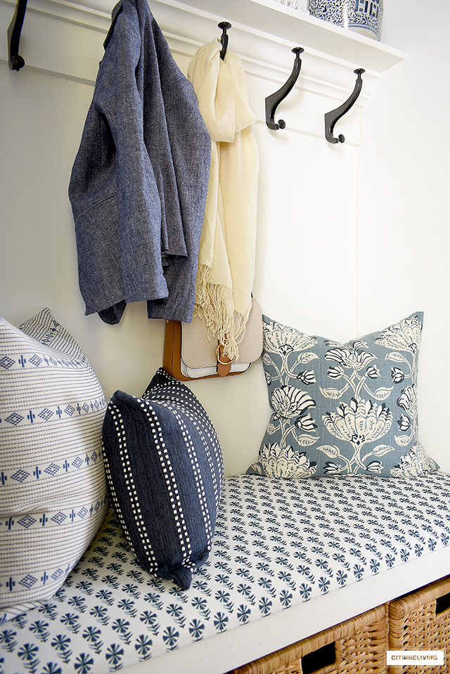 A beautiful builtin bench with gorgeous blue and white fabrics and pillows.