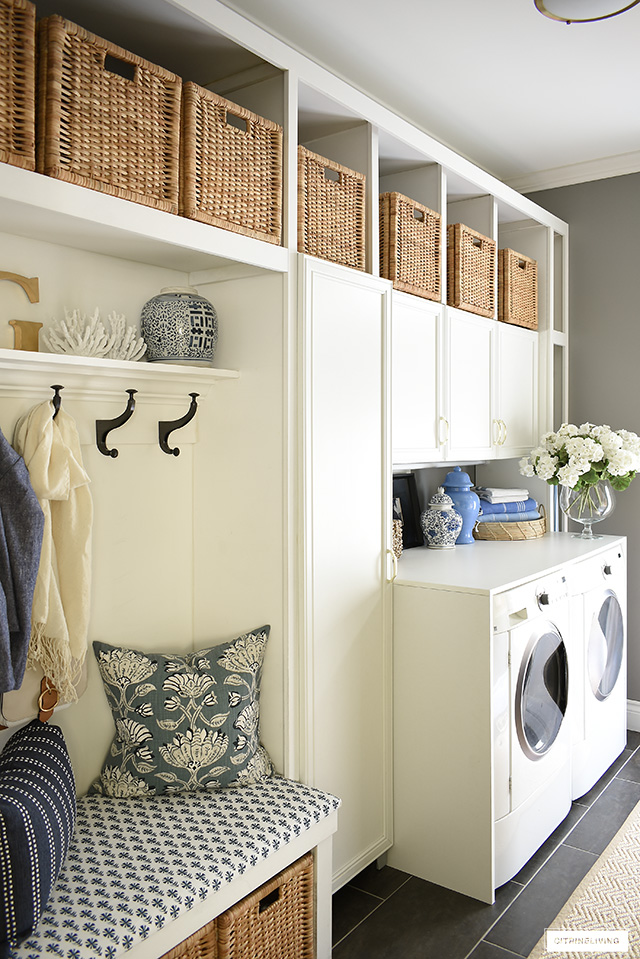 Laundry room with builtin cabinets and bench for storage and practical daily usage.