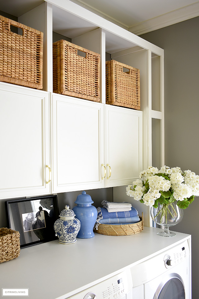 Style your laundry room with pretty details! Beautiful woven baskets and trays, turkish bath towels, faux flowers and ginger jars are always chic!