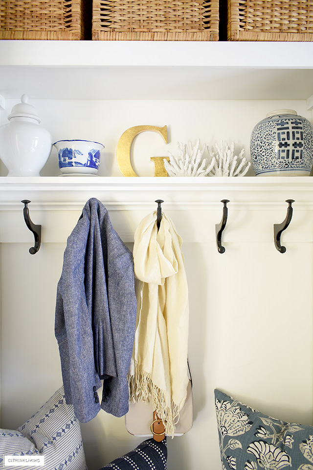 Beautiful chinoiserie decorative accents are chic and elegant in this mudroom/laundry room.