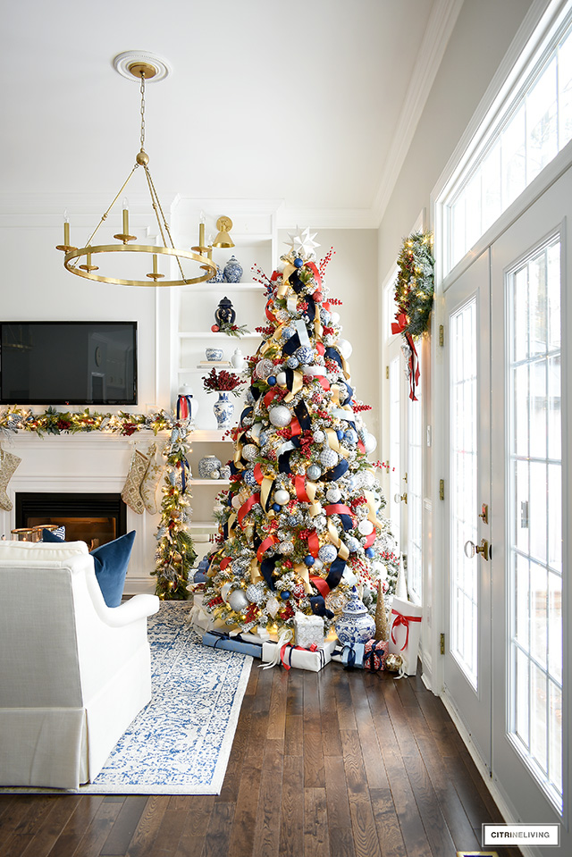 Sophisticated Christmas tree with red, blue, gold, silver and white decorations and ribbon is traditional and festive!