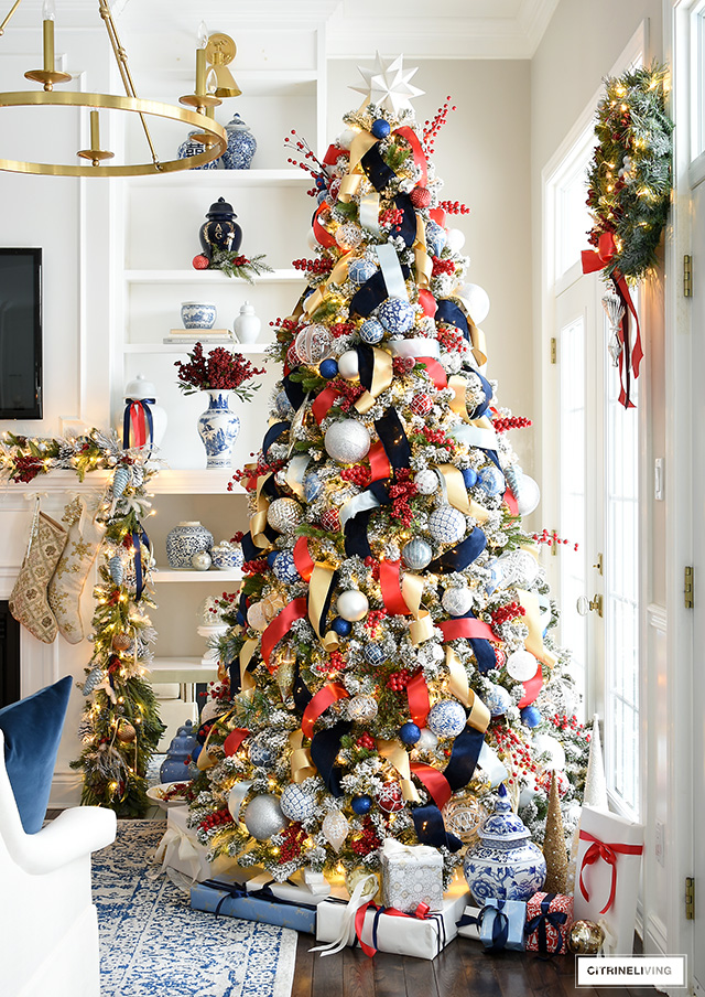 A gorgeous, traditional Christmas tree decorated in red, blue, white, silver and gold is festive and elegant.