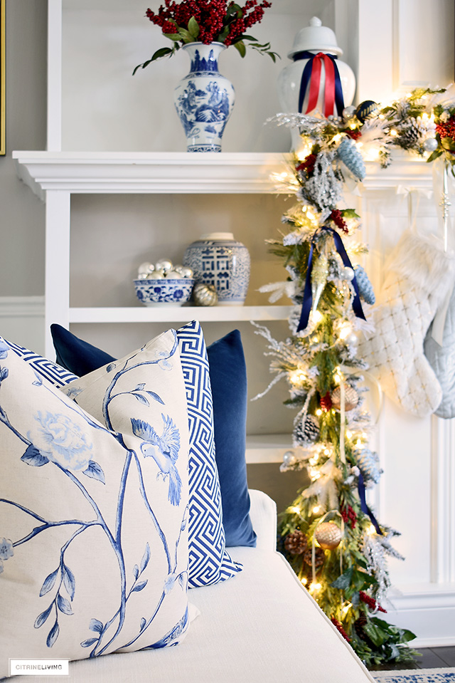 Gorgeous chinoiserie pillows are the perfect compliment to holiday decor in blue and white and red!