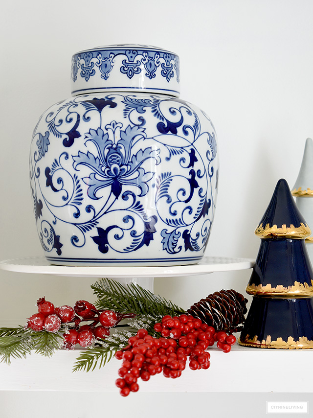 Prop a ginger jar on a cake stand to make it special! Add pine and red berries for a festive Christmas display.