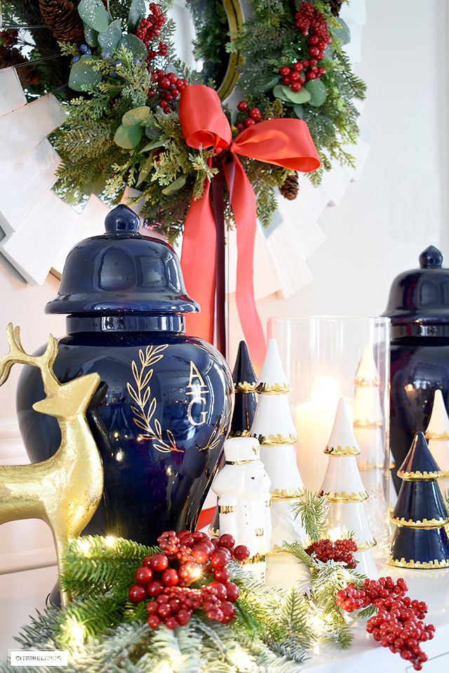 Chinoiserie Chic navy blue ginger jars with a gold monogram is a stunning focal point for a Christmas vignette.