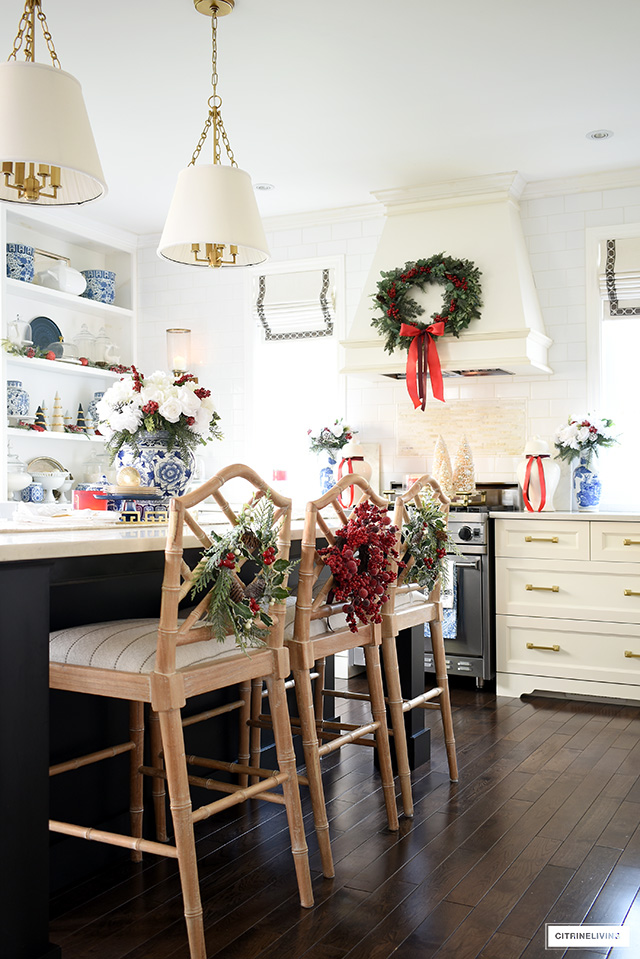 Barstools styled with beautiful Christmas wreaths is festive and fun!
