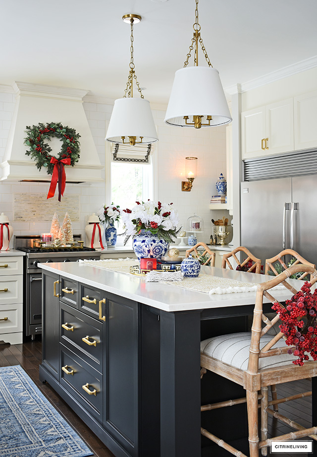 Christmas kitchen decor with blue and white chinoiserie, greenery and red accents is elegant and sophisticated.
