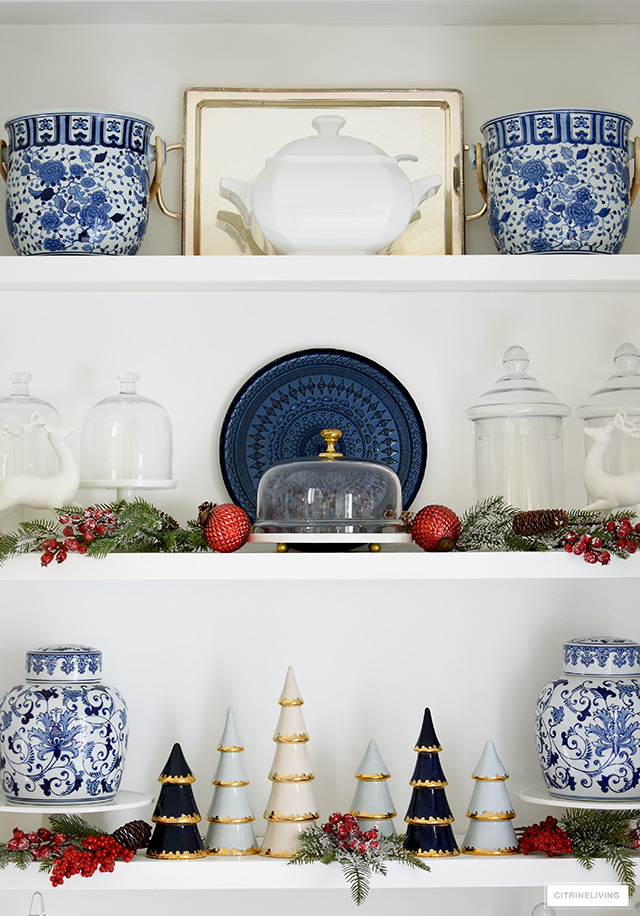 Christmas decorated kitchen shelves with blue, white, red and green elements.