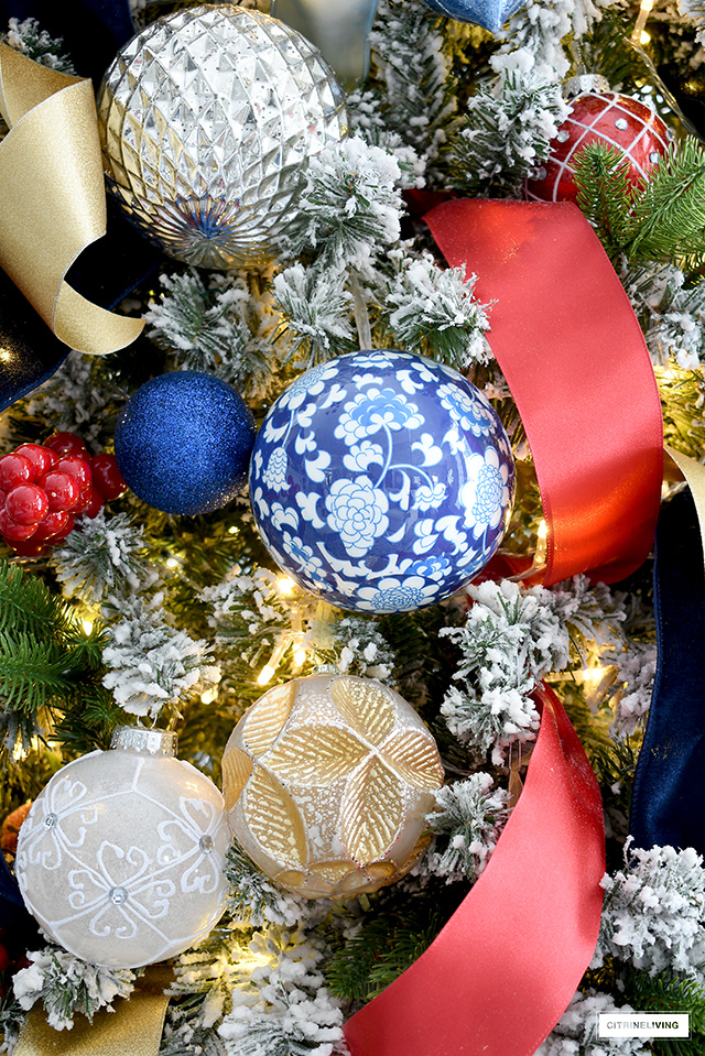 Beautiful and colorful Christmas tree decorations in blue, red, gold, silver and white.