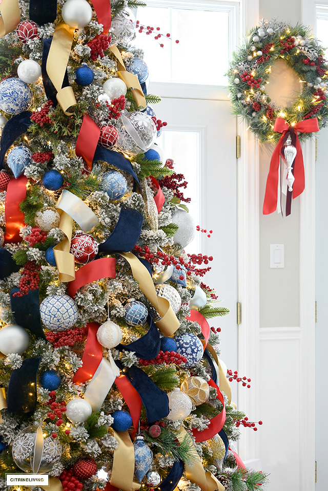 Gorgeous Christmas tree with blue and red, silver, white and gold decorations and ribbons.