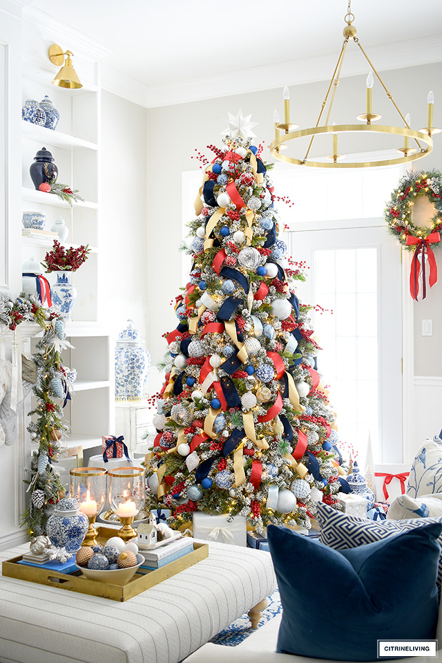 Gorgeous traditional blue and red Christmas tree with gold and silver accents is a rich and luxe look for the holidays.