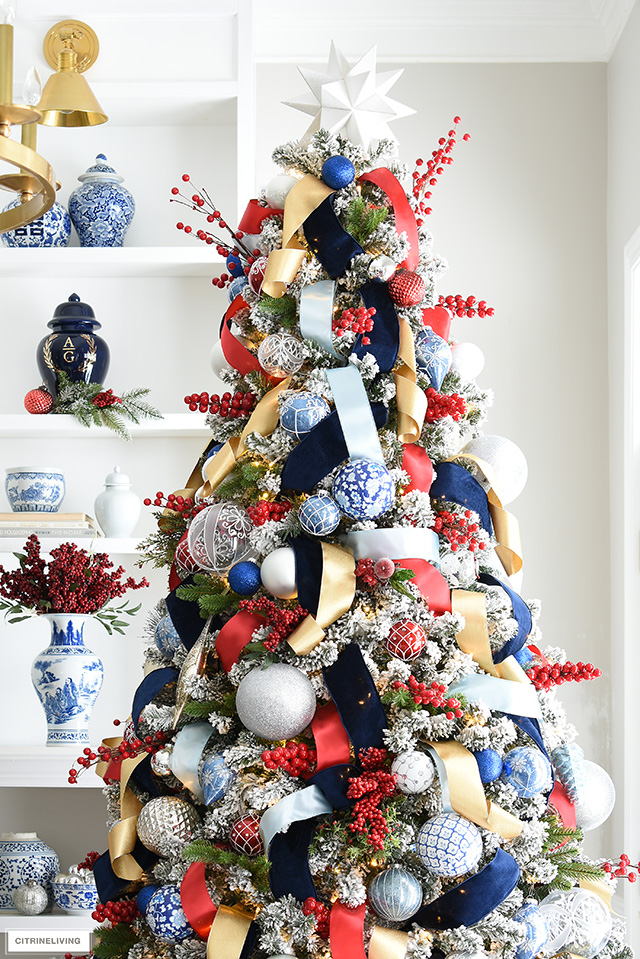 Stunning Christmas tree with red, blue, whit, gold and silver is rich, colourful and festive!