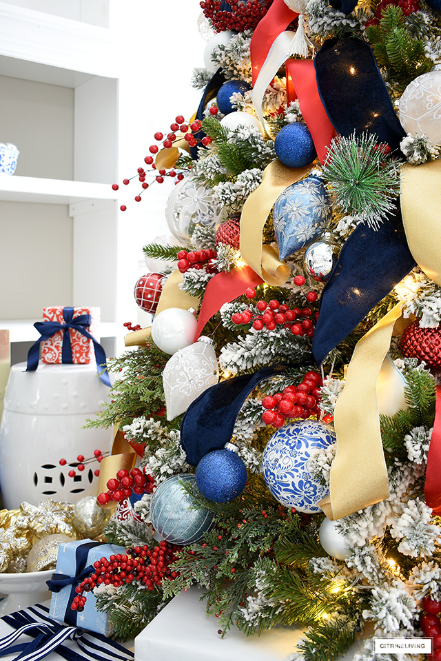 Beautiful and colorful Christmas tree decorations and ribbon in blue, red, gold, silver and white.