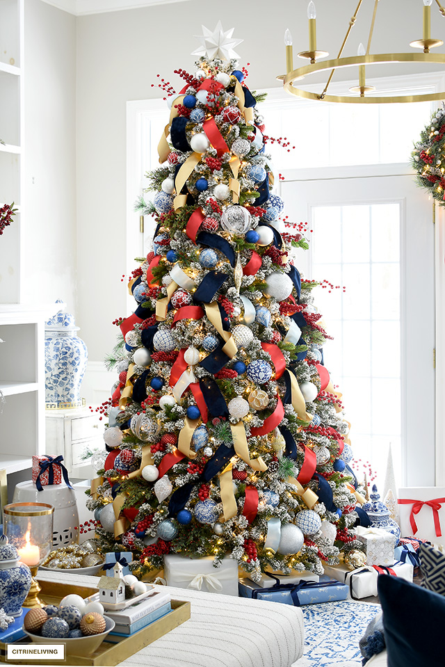 Sophisticated and luxe Christmas tree decorated in blue, red, white, silver and gold.