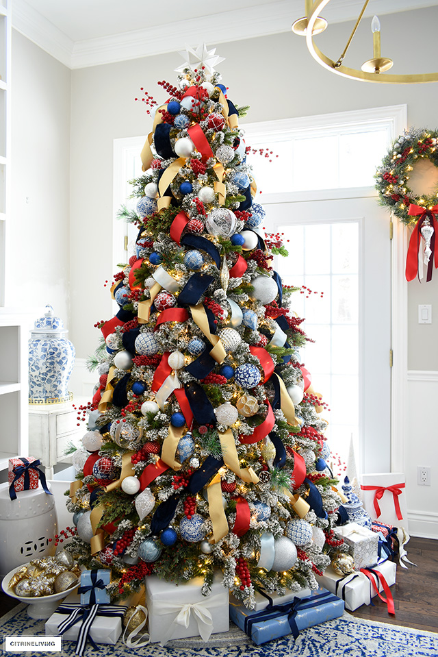 Sophisticated Christmas tree decorated in rich, luxe colors - red, blue, white, silver and gold.