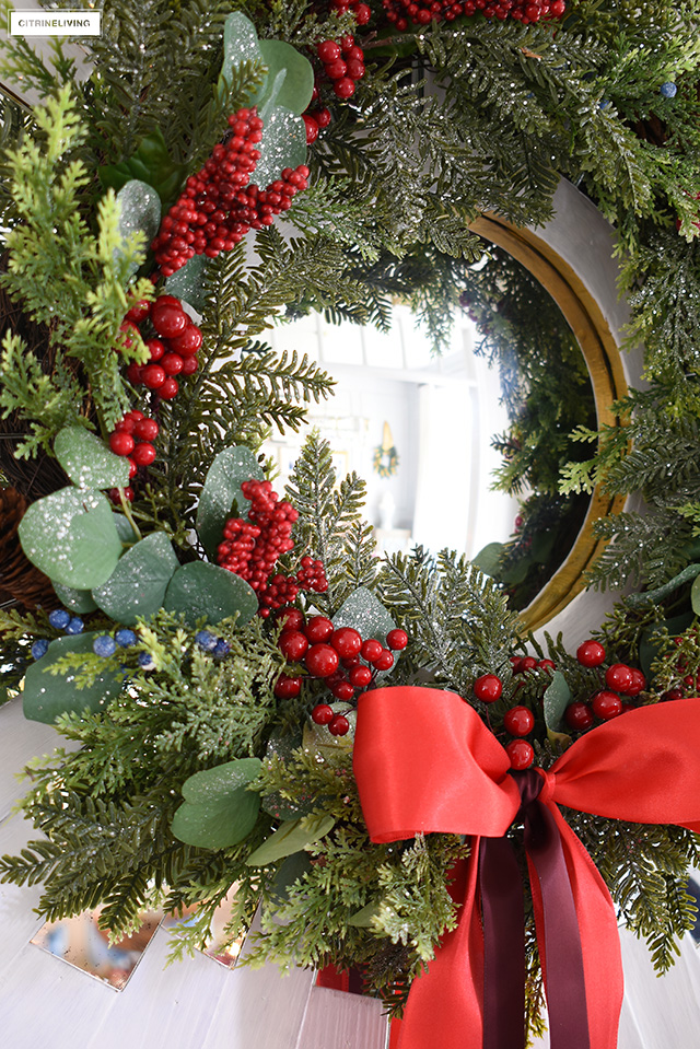 Add red berries in different sizes to a green wreath and dress it up with a red bow for a gorgeous classic look.