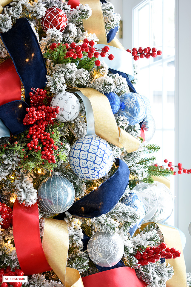 Beautiful, colorful Christmas tree decorations in blue, red, gold, silver and white is festive and elegant.