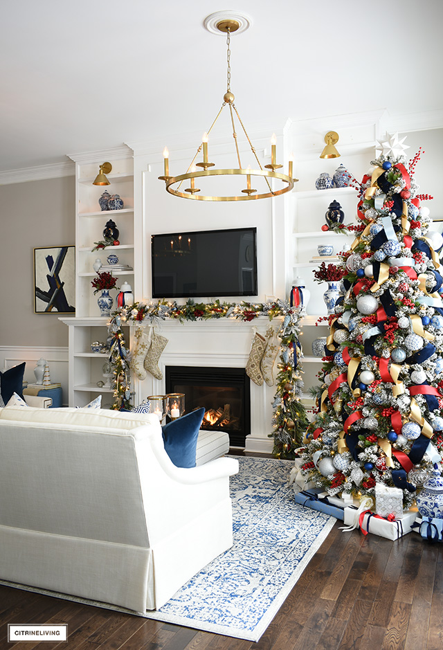 Sophisticated Christmas living room decor in blue, red white, gold and silver.