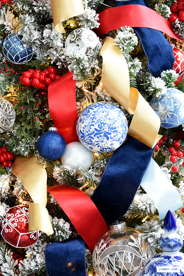 Gorgeous, colourful Christmas tree decorating in red, blue, white, silver and gold is festive and elegant.